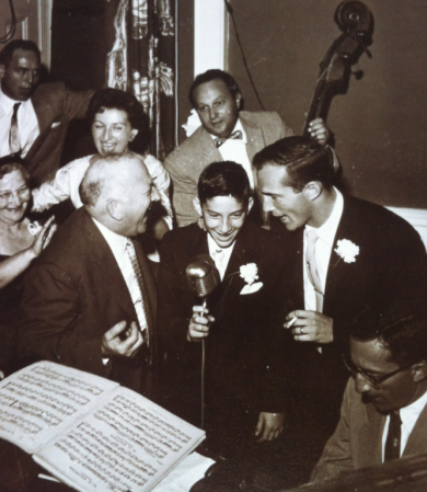 Bill Elgart with family and friends including father on piano, mother in white, uncles on each side sharing the microphone and Michael Kaye's father, Eddie Kaye playing bass in Massachusetts in 1955