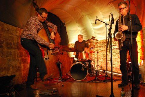 Meinrad Kneer, Bill Elgart and Ab Baars at Jazzkeller Sauschdall in Ulm, Germany (photo from Karin Mitschang)