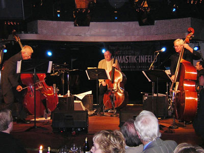 Bass Encounters featuring acoustic bassists, L-R, Arni Egilsson, Niels Henning Orsted, and Wayne Darling in Reykjavik, Iceland in 2004 (photo from allaboutjazz.com)